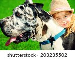 Stock photo happy little girl with her mastiff dog on a meadow in summer day 203235502