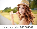beautiful young girl in summer... | Shutterstock . vector #203248042