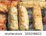 a lot of pork on the grill | Shutterstock . vector #203248822
