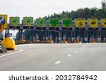 Small photo of Moscow, Russia - August, 2021: Highway toll stations with collecting booths. Roadway with car drivers needing to pay tolls to pass . Toll station highway road