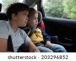 two boys in the car looking out ... | Shutterstock . vector #203296852