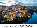 toledo cityscape at dusk spain | Shutterstock . vector #203298886