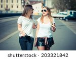 two beautiful young women... | Shutterstock . vector #203321842