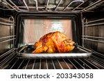 roast chicken in the oven  view ... | Shutterstock . vector #203343058