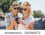 hip young couple looking at... | Shutterstock . vector #203366572