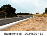 Scenic view on the gravel road with stones and vegetation on roadsides, selective focus. High quality photo