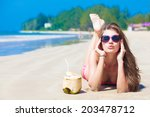 happy young woman with coconut... | Shutterstock . vector #203478712