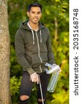 Small photo of Proud environment protection volunteer holding garbage and mechanical grabber