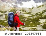 Senior Tourist Woman Hiking At...