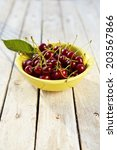 yellow bowl on old wooden table ... | Shutterstock . vector #203567866