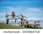 Tourist Couple Standing On The...