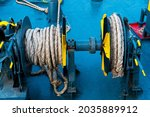Ferry deck. Drum with mooring rope close up.