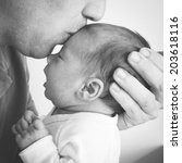 father kissing his baby in the... | Shutterstock . vector #203618116