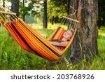 young woman lying in a hammock... | Shutterstock . vector #203768926