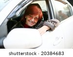 a smiling woman sitting in the...   Shutterstock . vector #20384683