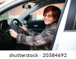 a smiling woman sitting in the...   Shutterstock . vector #20384692