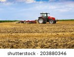 Tractor Cultivating Wheat...