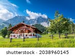 A large farm house in the mountains. Mountain house view. Farm house in mountains. Farm in mountainside