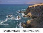 Rugged Coast With Blue Ocean...