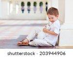 happy kid holding cute white cat | Shutterstock . vector #203944906