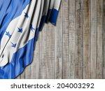 honduras flag with vertical wood | Shutterstock . vector #204003292