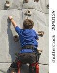 boy climbing rock wall series | Shutterstock . vector #2040129
