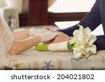 newlyweds holding hands in cafe | Shutterstock . vector #204021802