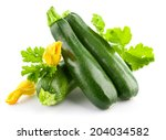 fresh zucchini with green leaf... | Shutterstock . vector #204034582