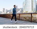 Young Asian Man Running Jogging ...