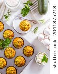 Small photo of Homemade zucchini muffins with feta cheese, savory courgette with ingredients