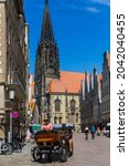 Small photo of Munster, Germany North Rhine-Westphalia August 15, 2021 Historical center of city. St Lambert's Church is a Roman Catholic church building.