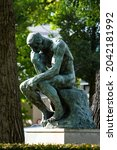 """Small photo of AMSTERDAM - AUGUST 25: view of famous statue of """"The Thinker"""" on August 25, 2021 in Amsterdam, The Netherlands.The Thinker is a world famous bronze sculpture made by Auguste Rodin."""