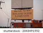 Small photo of Shawnee, Texas - USA - August 20, 2021 - A billboard advertising Shawnee Liquor uses the incorrect spelling of the word you're.