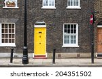 Yellow House Door On A London...