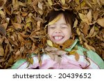 Girl Having Fun In The Leaves