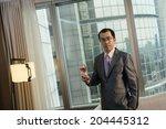 mature businessman holding a... | Shutterstock . vector #204445312