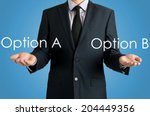 Small photo of man presents with their hands for a decision problem between option a or option b on blue background