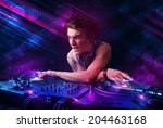 attractive young dj playing on... | Shutterstock . vector #204463168