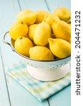fresh lemons in retro colander. | Shutterstock . vector #204471232