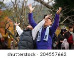 Small photo of Kyoto,JAPAN, NOVEMBER 20 : Japanese people stretching our arms in adoration of Shinto gods, in Mount Karama, Kyoto, Japan on November 20, 2011 .