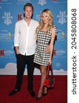 Small photo of LOS ANGELES - SEP 21: Barron Hilton II and Tessa Grafin von Walderdorff arrives for the 16th Annual Christmas in September Benefit on September 21, 2021 in West Hollywood, CA