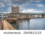 Front view on medieval Carrickfergus Castle, a Norman castle, situated in the town of Carrickfergus in County Antrim, Northern Ireland