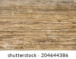Worn And Sandy Wood Planks For...