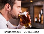 man drinking beer. side view of ... | Shutterstock . vector #204688855