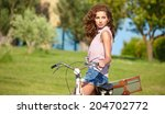 sexy woman with vintage bike in ... | Shutterstock . vector #204702772