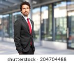handsome manager against blurry ... | Shutterstock . vector #204704488