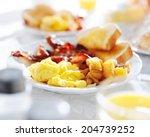 plate of breakfast food with... | Shutterstock . vector #204739252