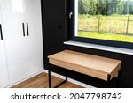 A Wooden Table Under The Window ...