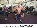 fitness class lifting barbells... | Shutterstock . vector #204786748