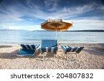two chairs   umbrella   Shutterstock . vector #204807832
